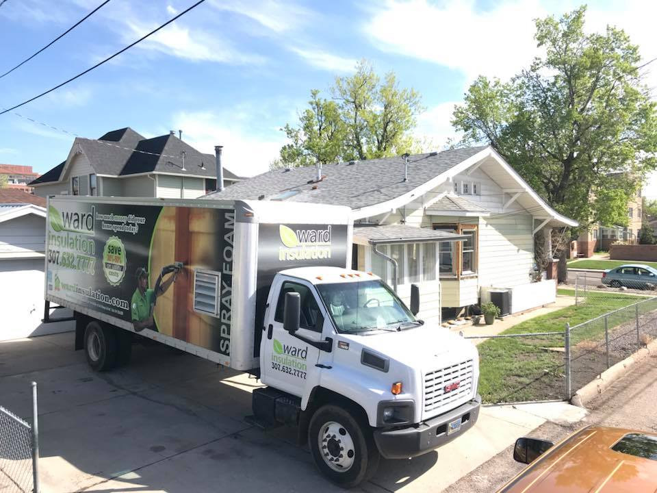 Ward Insulation truck in front of a home