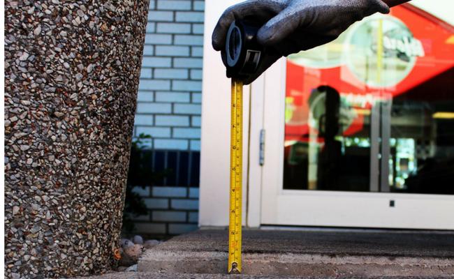 Ruler measuring sunken concrete