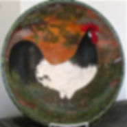 "Artwork by Sue Martin ""Painted Plate"" showing a black and white rooster"