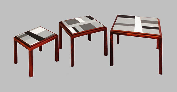 Three nesting tables made of wood with black, gray and white painted panels