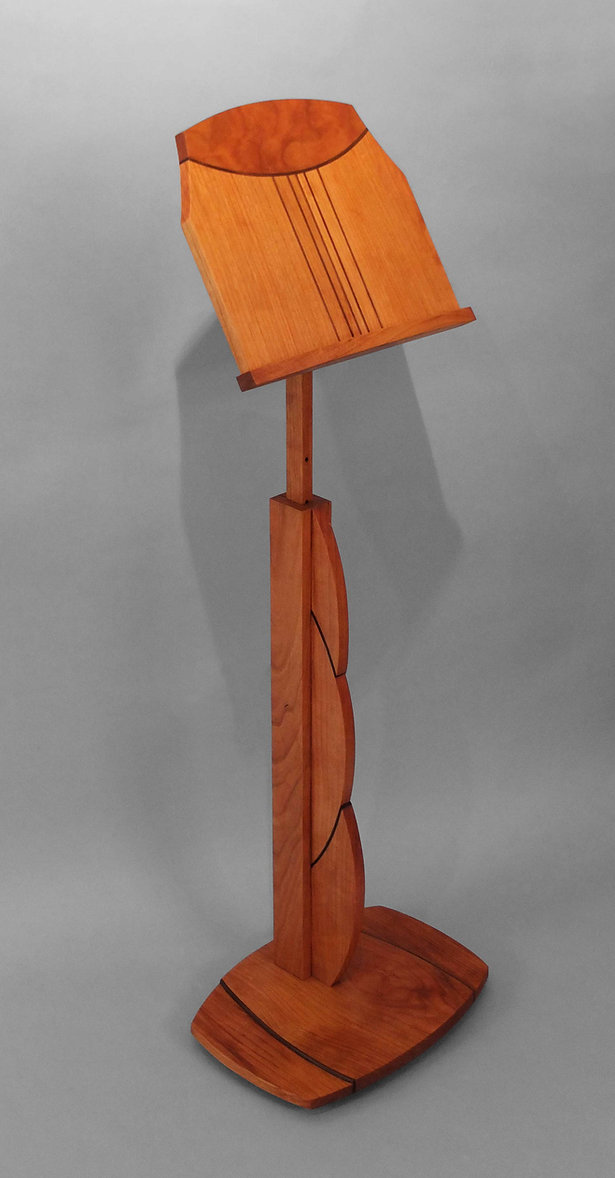 A wooden music stand made by Alan Reich