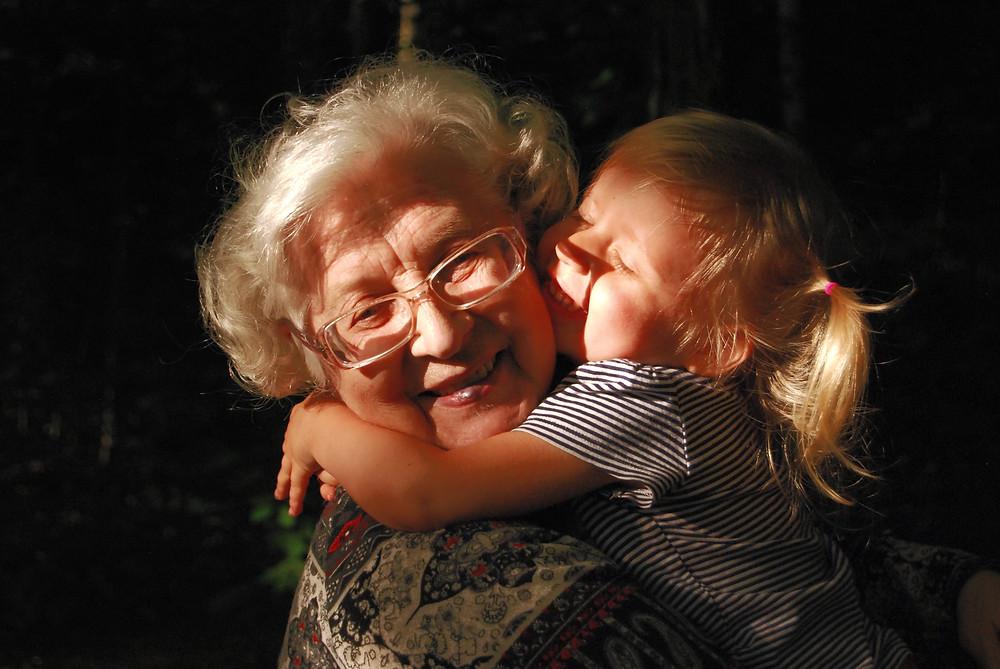 grandmother hugging child, madison wi