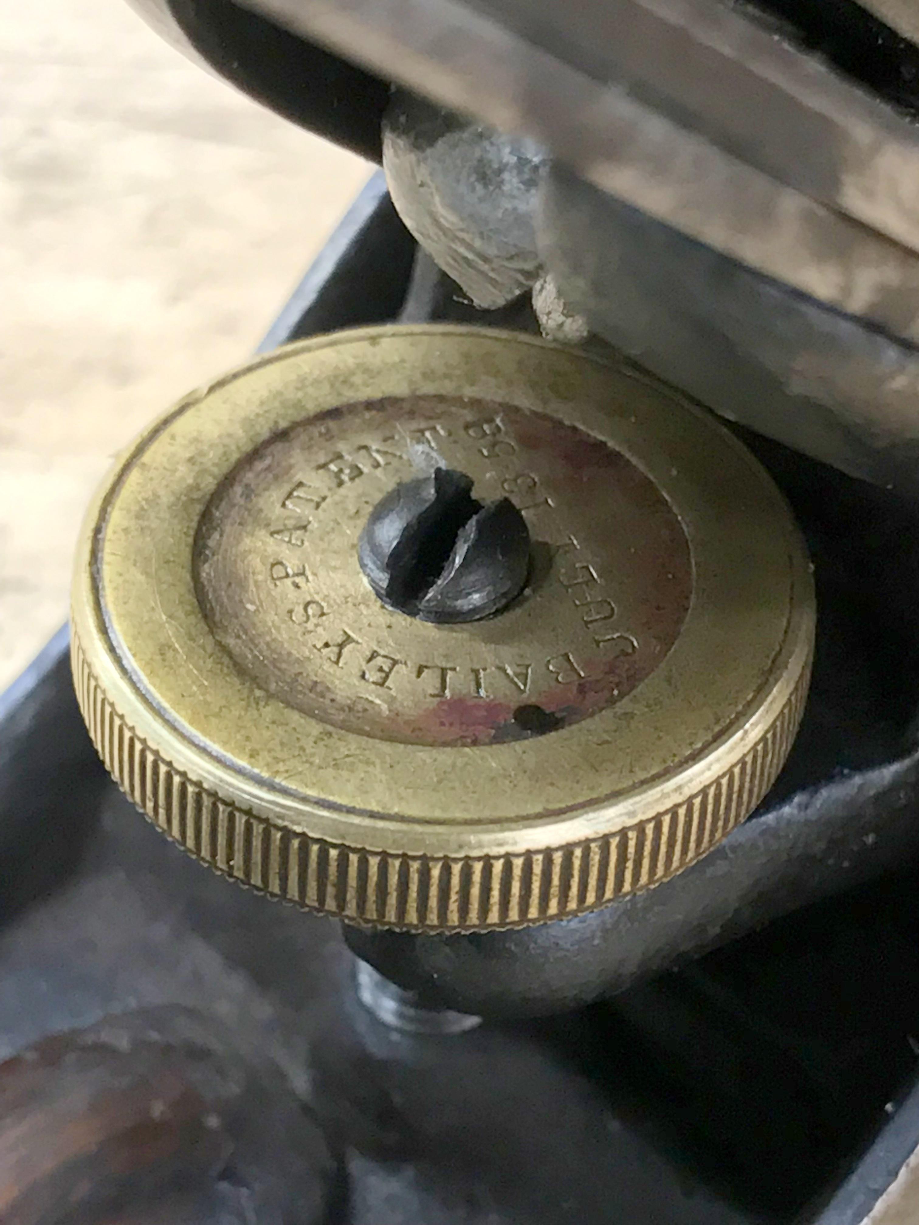 Vertical post adjusting knob.