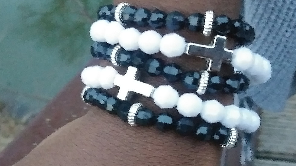 Layered black and white bracelets/ charms