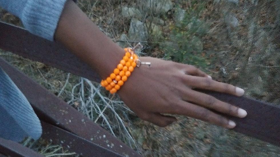 Orange Stack Bracelets w/ charms