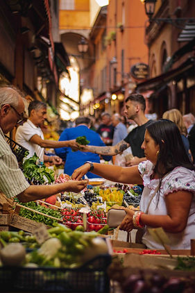 An image of people trading produce and goods at an outdoor market