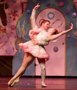 male dances with female ballerina