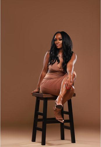 meek brown on stool.jpg