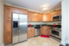 Midtown Manhattan Apartment - Kitchen. Staged to Sell. Douglas Elliman agent Iman Barkhordari.