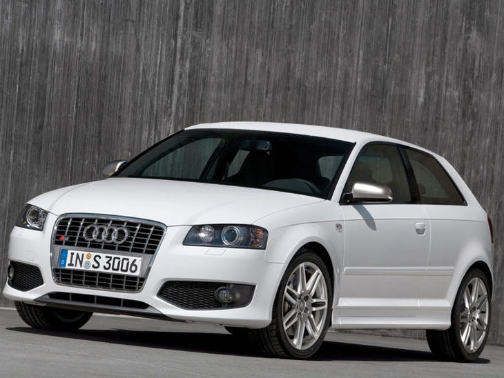 White Audi a3 parked in front of wall