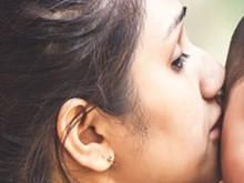KISSING SUFFERING ON THE CHEEK