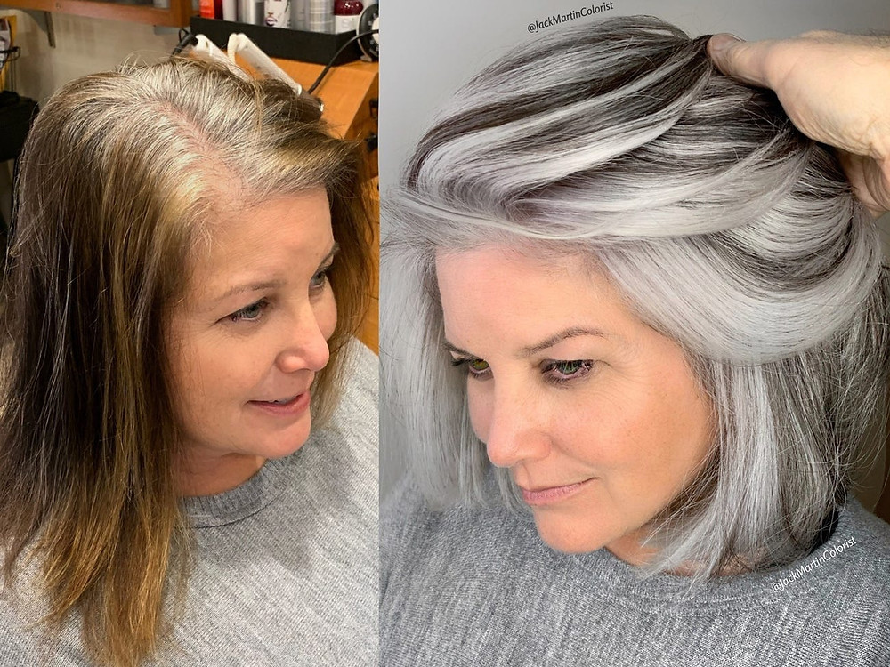 Woman transitioning from brown to gray hair.