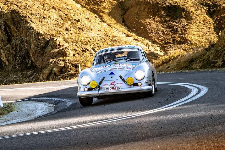 Classic Porsche 356 rally racing around a hairpin corner