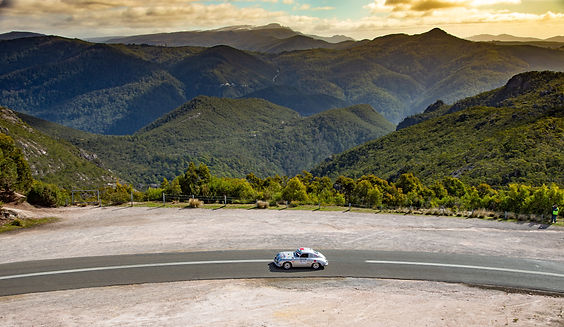 Classic Porsche 356 drriving on an empty Australian road