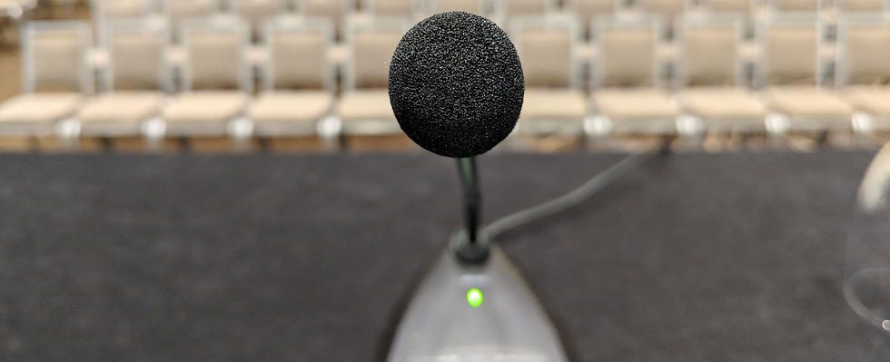 GLOBAL EVENTS image showing a microphone facing front of the camera.