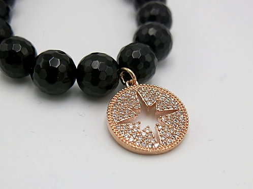 handcrafted black onyx stretch bead bracelet with micro pave round starburst rose gold disc