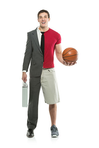Young man wearing half suit half shorts holding basketball and suitcase.