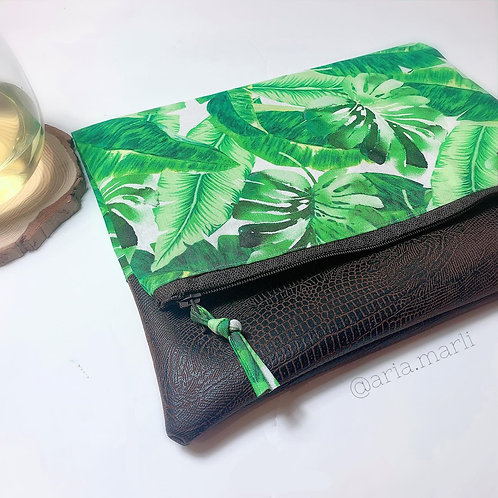 Monstera Print handsewn foldover clutch.