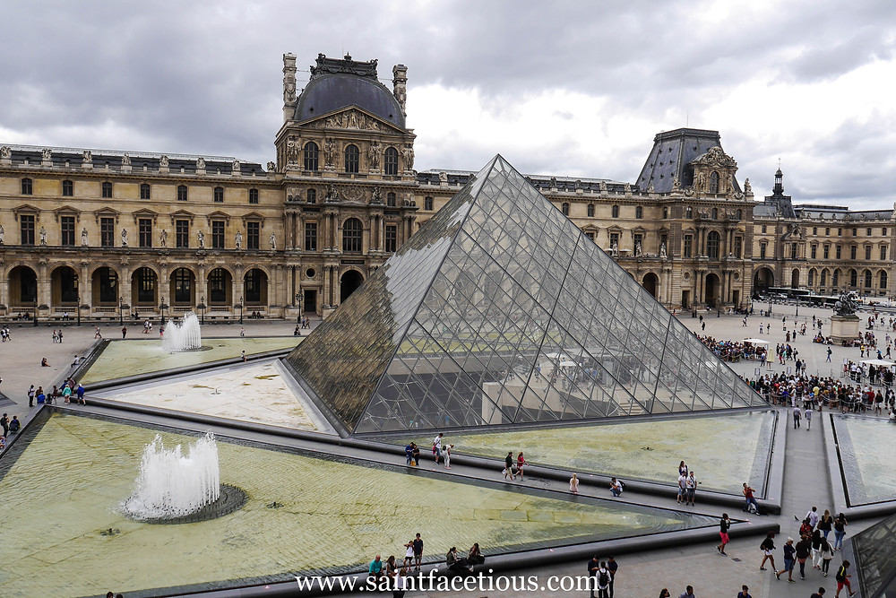 The pyramid entrance of the Louvre. Everybody knows the Louvre and the Mona Lisa. But here are some tips for managing your tour for just a few hours and beating the lines. Read all about it on the blog, www.saintfacetious.com