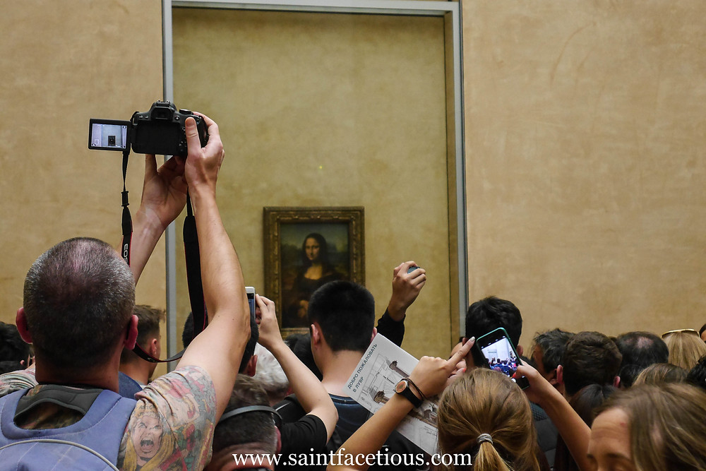 The Mona Lisa at the Louvre. Everybody knows the Louvre and the Mona Lisa. But here are some tips for managing your tour for just a few hours and beating the lines. Read all about it on the blog, www.saintfacetious.com