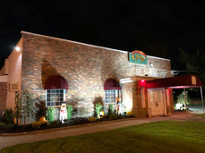VFW Hall lit up at night time