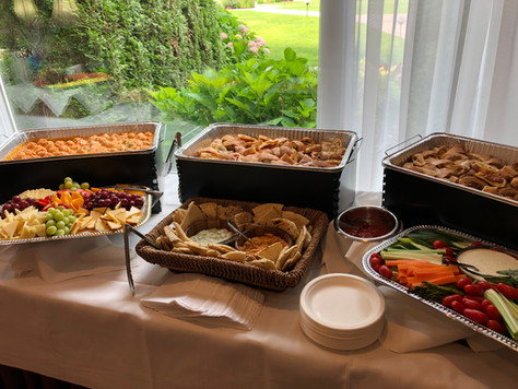 Hot and cold appetizer table catered by Felico's Catering