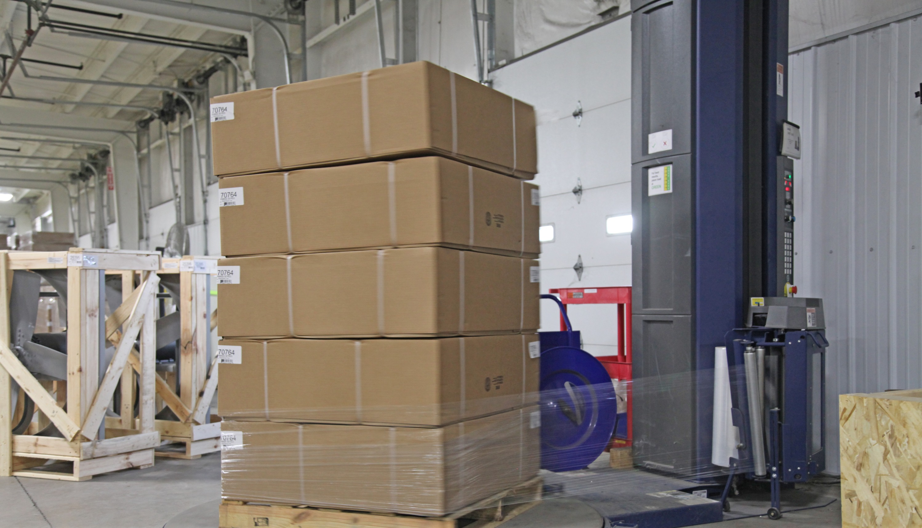 Logistics - Shrink wrapping to prep for outgoing shipment