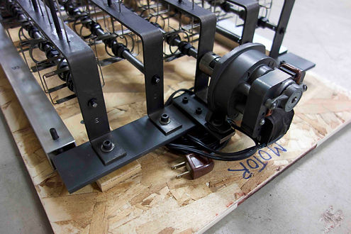 Coiling the electrical cord for shipping The crate support base brackets for Machine with 23 Scraps of Paper by Arthur Ganson