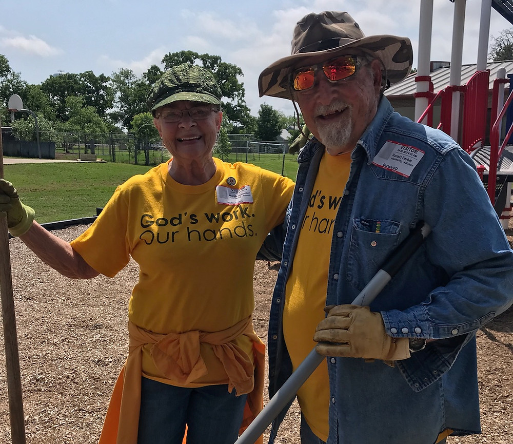 Volunteers Margie and Ron help with McDade playground build preparation.