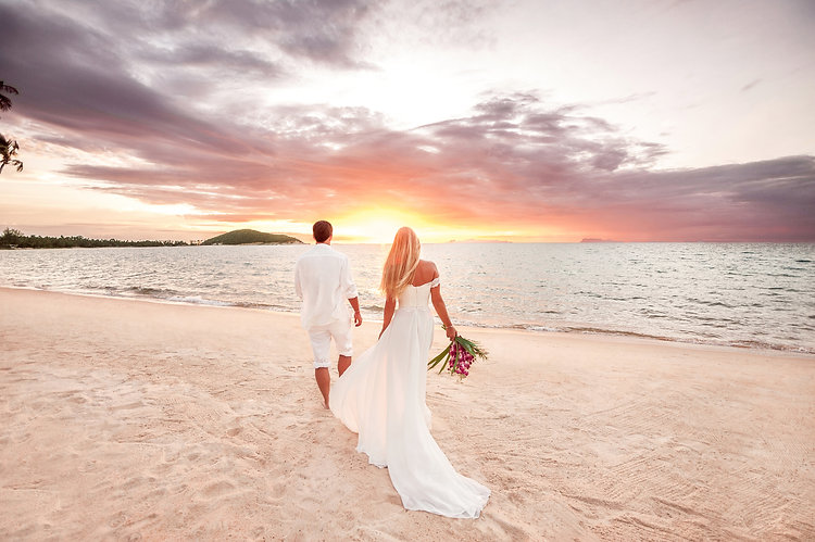 beautiful couple at sunset near the ocean.Honeymoon romantic couple in love holding hands