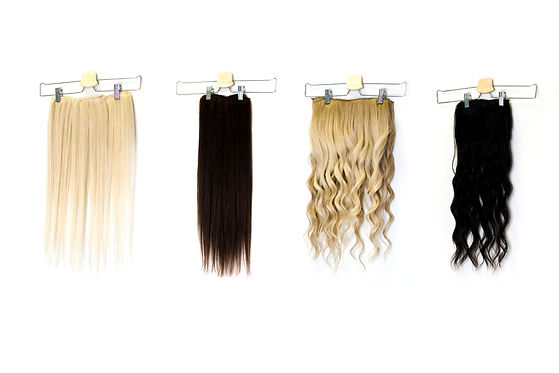 Natural human hair extensions hung on a