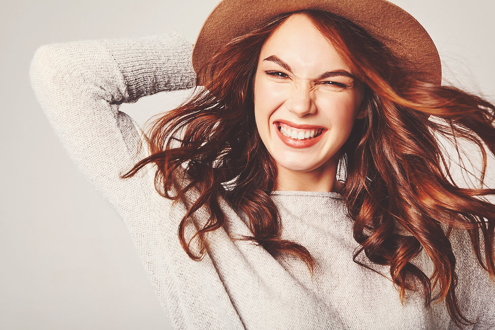 Portrait of young stylish laughing girl