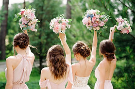 Bridesmaids in pink dresses and bride holding beautiful bouquets. Beautiful luxury wedding