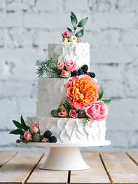 White wedding cake with flowers and blueberries.jpg