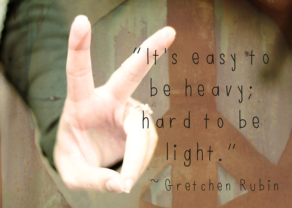 "hand in peace symbol and quote ""It's easy to be heavy; hard to be light."" by Gretchen Rubin"