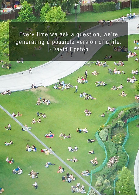 "a photo taken from a height above looking down on a large lawn with people scattered about reading, eating and resting.  The quote on the image says ""Every time we ask a question, we're generating a possible version of a life."" by David Epston"
