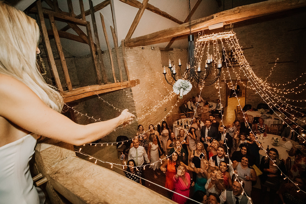wedding, party, reception, kingscote, barn, band, music, dancing, photographer, documentary style, candid, first dance,intimate, atmosphere, sunset, wedding, venue, costwolds, south wales, wedding, photographer, neil, williams, photography, bouquet toss, balcony