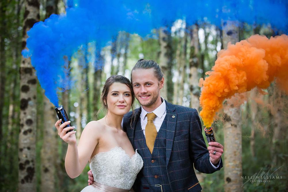 pembrokeshire photographer, neil williams photography, outdoor wedding, hilton court, happy couple, summer wedding, best welsh wedding photographer, wedding, guests, mother of the bride, outdoor ceremony, bride & groom, south wales wedding photographer, white bride narbeth, bridal portrait, bride and groom, woodland, wedding, smoke grenades,