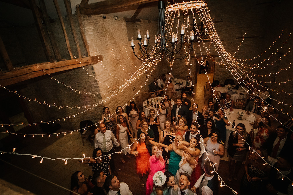 wedding, party, reception, kingscote, barn, band, music, dancing, photographer, documentary style, candid, first dance,intimate, atmosphere, sunset, wedding, venue, costwolds, south wales, wedding, photographer, neil, williams, photography, bouquet toss, balcony,