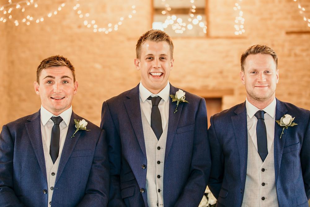 groomsmen, best men, best man, navy and gray suits, suites, three piece, buttonholes,
