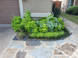 Low maintenance entrance with custom stone pathway