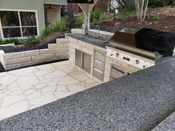 Custom stonework and edging for a second kitchen poolside