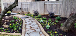 Stone and decomposed granite pathway with mulched beds installed Austin, TX