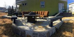 Stone patio w custom railing porches