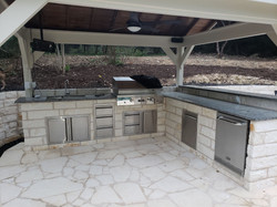 Fully equipt outdoor kitchen - Storage, roof, fridge, tv, full bar, fan, water, electric, sink, and
