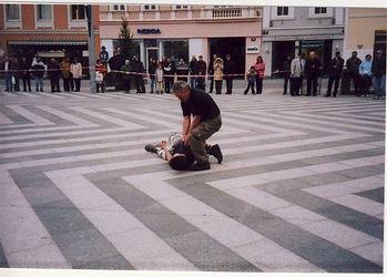 krav maga self defense in public place on the floםר