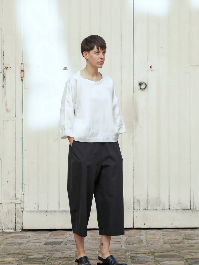 Top : THIBAUD White Pants : PIERRE Black