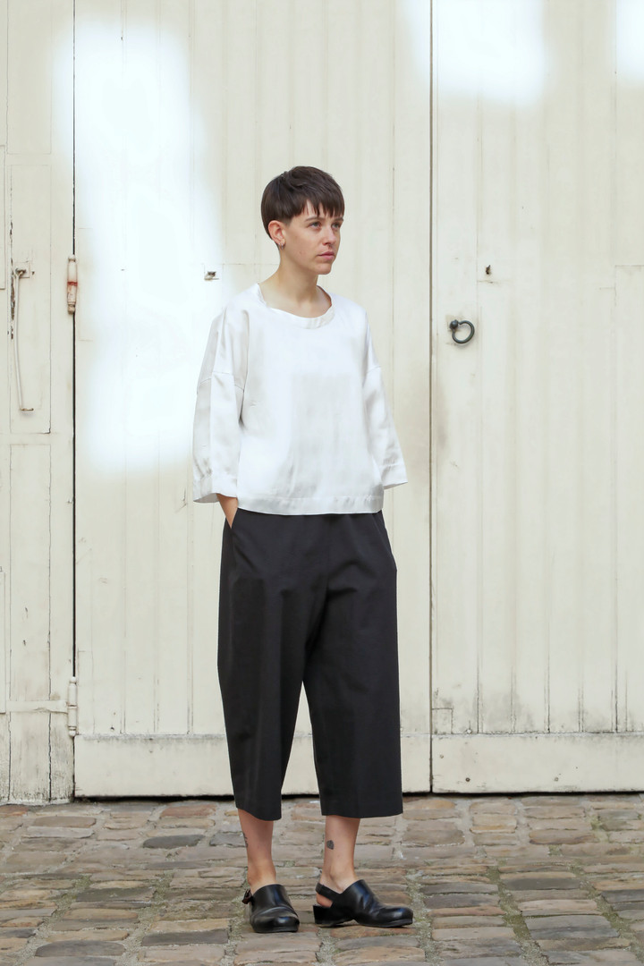 Top : THIBAUD White Pants : PIERRE Black
