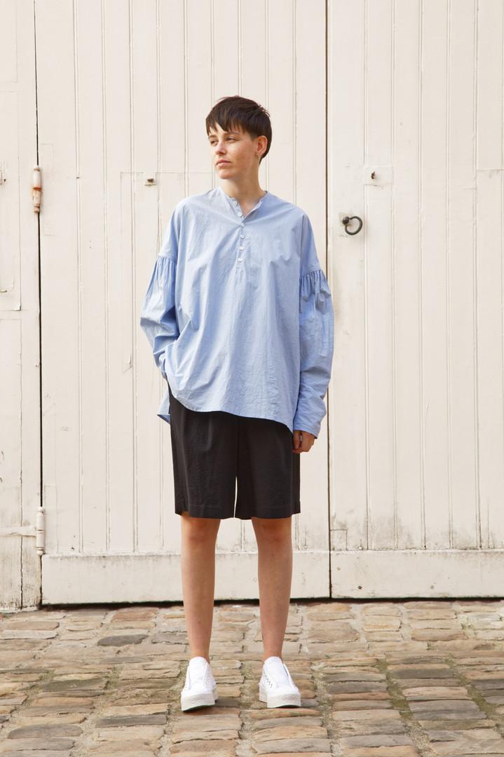 Shirt : BASIL Light blue Pants : PATRICE Black