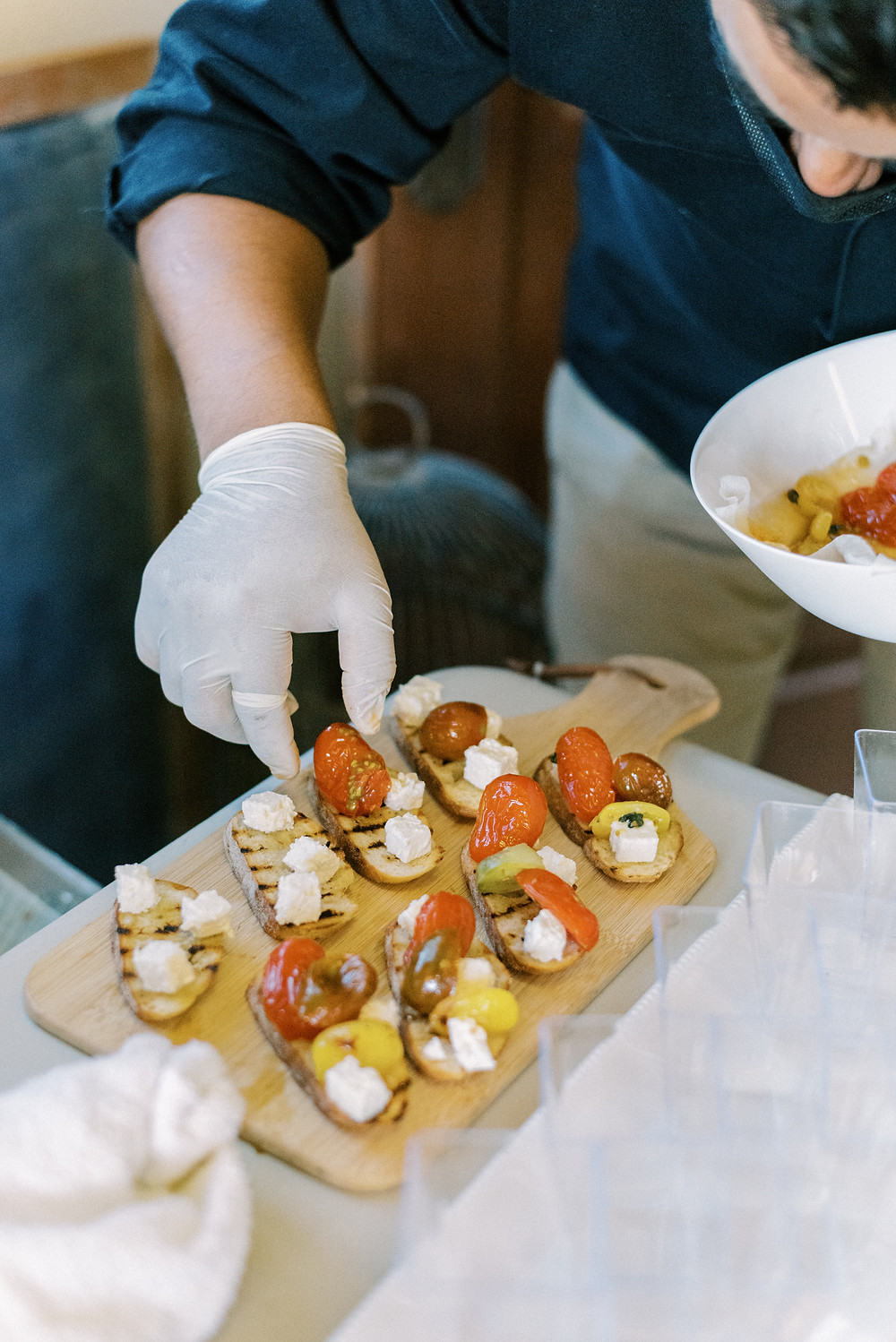 @chefjuancateringkitchen preparing delicious appetizers, paying close attention to the detail of food placement to look picture perfect